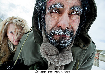 Freezing struggling couple survivers - Close-up of ...
