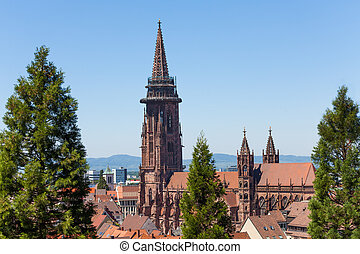 Freiburg cathedral tower against blue sky, Germany, Europe