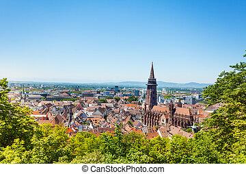 Freiburg cityscape with Munster against blue sky - Freiburg...