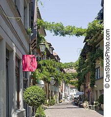 Freiburg im Breisgau street scenery - sunny illuminated city...
