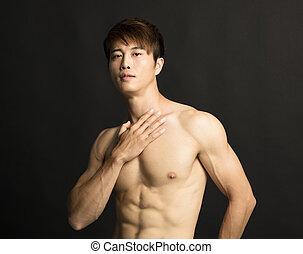 freigestellt, muskulös, junger, schwarzer hintergrund, mann