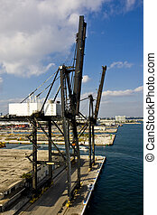 Freight Cranes at Harbor - An industrial area on the coast...