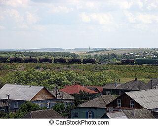 Freight - Oil railroad tanks slow move near village