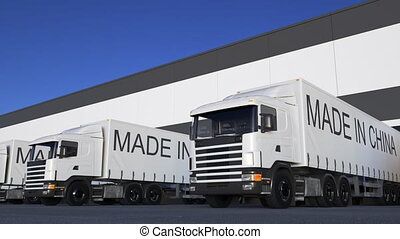 Freight semi trucks with MADE IN CHINA caption on the...