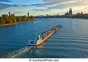 freight ship on river Rhine by Cologne in Germany