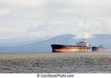Freight shipment - Cargo ship leaving Columbia river delta,...