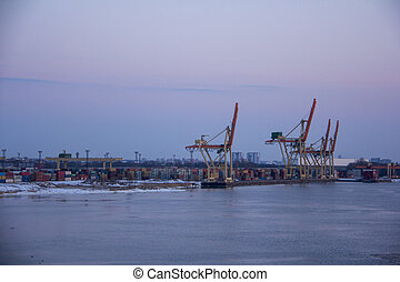 freight shipping containers and gas tanks at the docks. in import export and business logistic. Trade Port, Ship cargo to harbor.