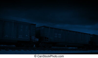 Freight Train Carriages Passing At Night - Industrial...