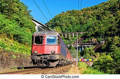 Freight train goes down the Gotthard pass - Switzerland -...