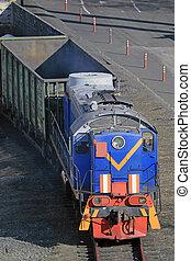 Freight train hauled by diesel locomotive.