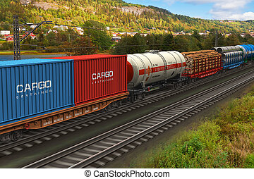 Freight train passing by mountain range - Scenery of the...