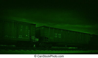Freight Train Passing Night Vision - Freight train passes by...