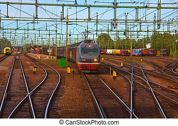 Freight train passing railway station