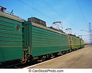 Freight train - Green Freight train passes a station