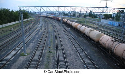 Freight train rides under the bridge, top view