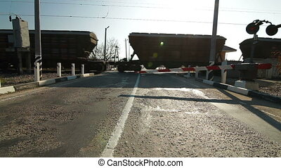freight train at a railway crossing