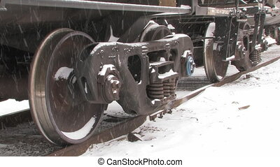 Freight train wheels in snow.