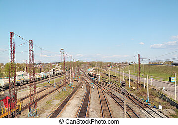 Freight trains at railway station with many old railroads