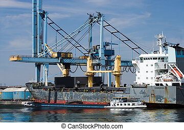 Freight transfer - Freight being transferred from a large...