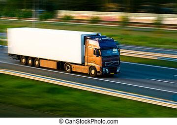 Freight truck on motorway. Motion blur