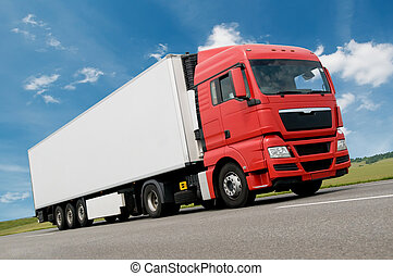 Red white Long vihicle truck in motion on road