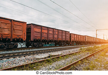 Freight wagons with solid cargo on the railway.