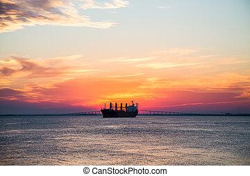 Freighter on Sunset Horizon