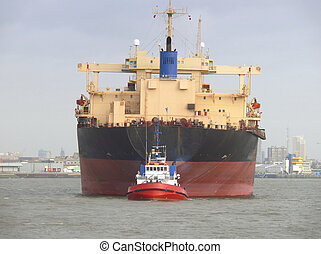 Freighter with Tugboat - Frontal View