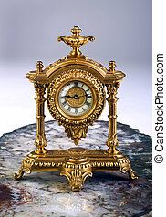 Antique French gold clock made in the late 1800's.