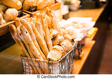 French baguette and bread in basket