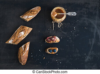 French baguette cut into pieces, sandwiches with red grapes...