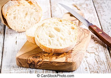 French Baguette on cutting board