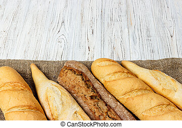 French baguette on the kitchen table. Close-up
