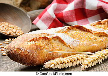 French baguette on the wooden table