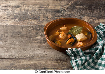French bouillabaisse soup on wooden table