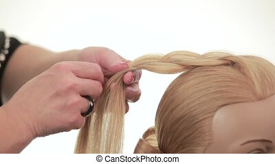 French braid. Weave braids for long hair. Close up - Barber...