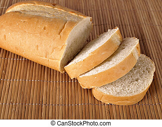 French Bread - A loaf of French Bread on a place mat
