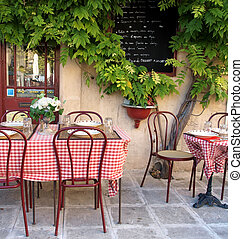 French cafe in Provence - tranquil setting at a sidewalk ...