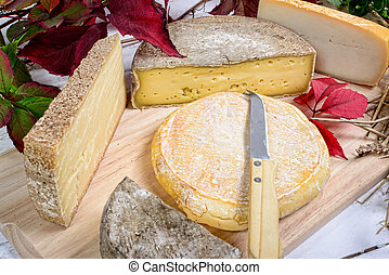 french cheese platter on the wooden table