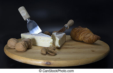 french cheese with croissant bread - wooden rotatable...