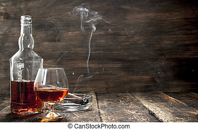 French cognac with a smoking cigar.