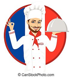 french cuisine chef with funny big mustache holding a silver tray