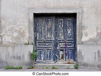 vintage blue wooden door, seen in Paris France