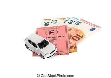 French driving license valid in all European countries on white background and money. Concept : Driving license is expensive in France.