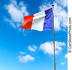 French flag on a background of blue sky