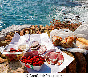 French food picnic outdoors near sea with market food. -...