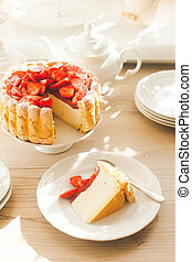 French Fresh Strawberry charlotte cake with teapot