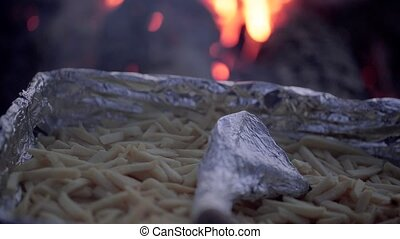 French Fries cooking over a campfire