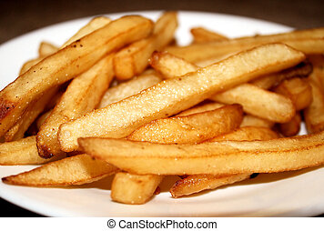 French Fries - Crisp golden french fries on plate