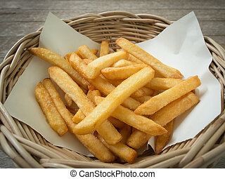 French fries /fried potatoes in basket